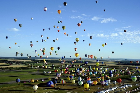 """Hot air balloons rise in Chambley-Bussieres, eastern France, during the """"Lorraine Mondial air ballons"""" event.  Photo: AP Alexandre March, L'est Republicain, Pool"""