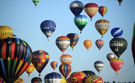 Hot air balloons soar through the air.  Photo: Rex Features: POL EMILE/SIPA