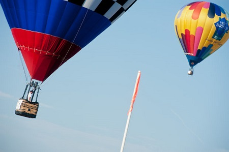 Balloons - Rhett Heartsill attempts to maneuver his balloon closer to the pole during the final day of the Great Texas Balloon Race and U.S. National Hot Air Balloon Championship. Photo: Michael Cavazos/News-Journal