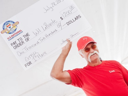 GTBR Champion - Balloonist Wil LaPointe is awarded with a check for $1,200 after taking first place in the Great Texas Balloon Race Sunday at East Texas Regional Airport.  Photo: Michael Cavazos/News-Journal