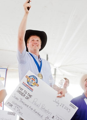 National Champion - Balloonist Paul Petrehn is awarded with a check for $7,500 after taking first place in the U.S. National Hot Air Balloon Championship Sunday at the East Texas Regional Airport.  Photo: Michael Cavazos/News-Journal