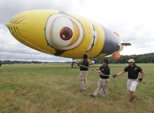 1.Crew members steady the Despicablimp on tour at Akron Fulton Airport. The A-150 blimp is 165 feet long, 55 feet high and 46 feet wide. Photo: Phil Masturzo - Akron Beacon Journal