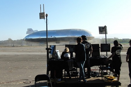 The ground control team monitors progress as the Aeroscraft airship hovers nearby.  Photo: Aeros