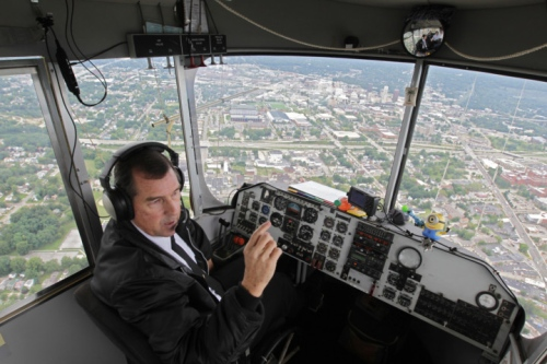 Airship Capt. Allen Judd talks about the Despicablimp tour after takeoff from Akron Fulton Airport.  Photo: Phil Masturzo - Akron Beacon Journal