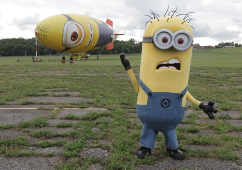 A minion greets riders going on the Despicablimp tour at Akron Fulton Airport.  Photo: Phil Masturzo - Akron Beacon Journal