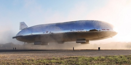 The airship clearly shows the four landing pads. The two small side engines are tilted up in the takeoff position, and an engine in the tail helps with control. The crew sit in the small gondola in the center of the ship.  Photo: Aeros
