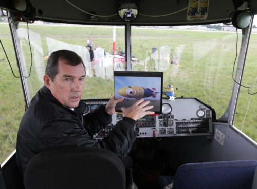Airship Capt. Allan Judd talks about the workings of the Despicablimp before takeoff at Akron Fulton Airport.  Photo: Phil Masturzo - Akron Beacon Journal
