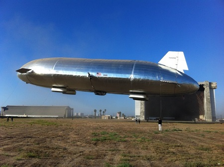The large silver airship harkens back to an earlier day when giant airships glided gracefully through the skies. This is the first flying fully-rigid airship since the 1940's . Photo: Aeros