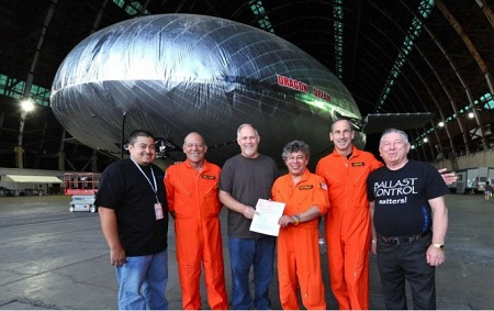 Pictured (L-R) Alex Canto, Director of Quality Control; Corky Belanger,Sr., Test Pilot; Kurt Krumlauf, Sr. Aviation Safety Inspector for the FAA, Igor Pasternak, CEO/Flight Engineer, General Raymond Johns, Test Pilot; and Anatoliy Pasternak, VP of Production with the FAA airworthiness certificate for the Aeroscraft  Photo: Aeros