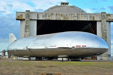 The Aeroscraft Airship sits outside the massive hanger in Tustin, California after its many-year gestation. It rests on four hovercraft pads instead of wheels.  Photo: Aeros
