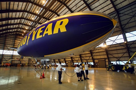 02The ground crew members prepare The Spirit of Innovation in the hangar.  Photo: Mike Stocker / Sun Sentinel