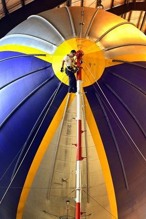 03A ground crew member prepares The Spirit of Innovation in the hangar.  Photo: Mike Stocker / Sun Sentinel