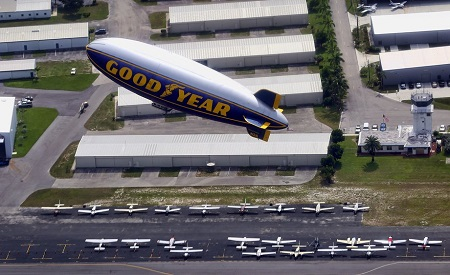 Looking out the windows of The Spirit of Innovation, The Spirit of Goodyear takes off from Pompano Beach.  Photo: Mike Stocker / Sun Sentinel