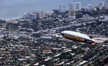 Looking out the windows of The Spirit of Innovation, The Spirit of Goodyear flies over Pompano Beach.  Photo: Mike Stocker / Sun Sentinel