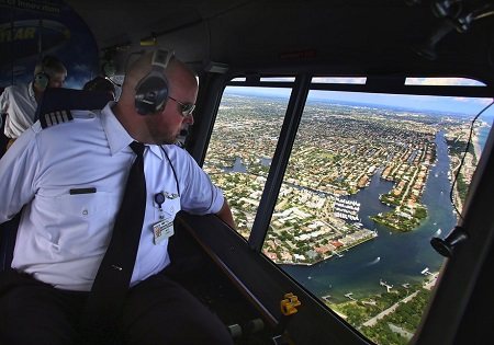 Matt Lussier piloting The Spirit of Innovation over Pompano Beach.  Photo: Mike Stocker / Sun Sentinel