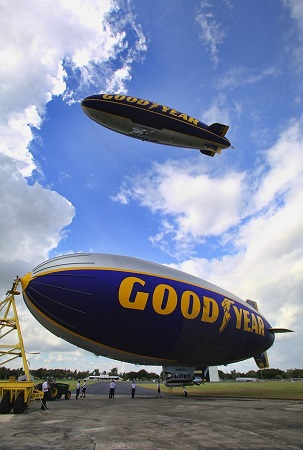 The Spirit of Innovation is on the ground as The Spirit of Goodyear flies overhead.  Photo: Mike Stocker / Sun Sentinel