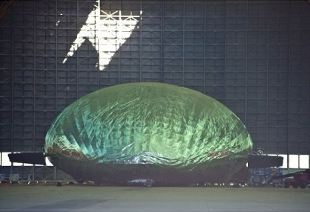 Sunlight streams in from a 25-foot-by-25-foot hole above the damaged Aeroscraft helium filled airship in the north Tustin hangar Monday morning after section of the roof collapsed. Photo: Sam Gangwer, Orange County Register