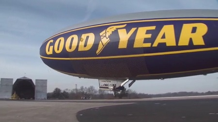 The Spirit of Goodyear taking flight at the Wingfoot hangar.