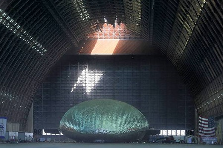 Sunlight pours through a hole in the roof of a hangar in Tustin, illuminating an airship being built for the U.S. military. A portion of the hangar's roof collapsed Monday, damaging the $35-million project inside.  Photo: Mark Boster / Los Angeles Times