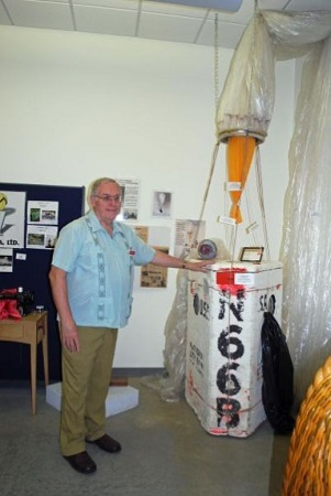 Dennis Nicholson, assistant curator at the National Balloon Museum stands by a display of a hydrogen balloon flown by Tracy Barnes who set a world altitude record with the craft in 1964. The balloon soared to a height of 37,820 feet. Photo: Terry Turner