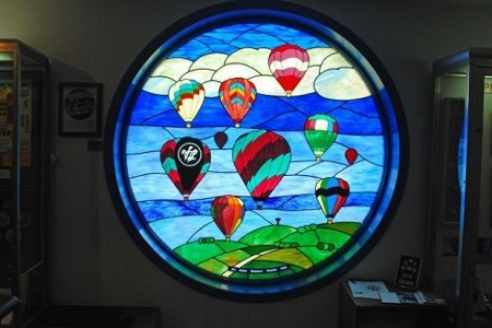 A 6-foot stained glass window in the National Balloon Museum honors the memory of Jill Ruben a local balloon pilot, museum board member and volunteer who died in October 2000. The window was designed by Indianola artist Grant Dyer. Photo: Terry Turner
