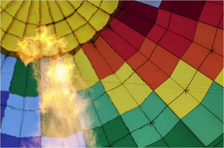 "A propane-fueled flame heats the air in the balloon before takeoff, causing it to expand. ""I like to say that my heart leaps up when I behold a dragon in the sky,"" Mr. Holmes said, repurposing a poem by Wordsworth, one of his favorite writers.  Photo: Tony Cenicola/The New York Times"