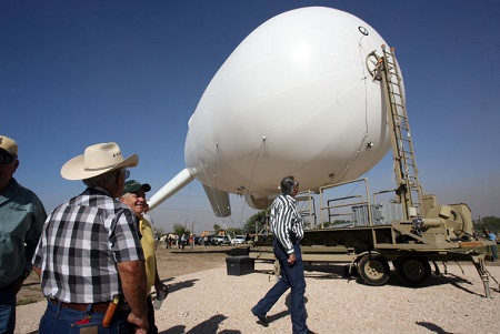 On Tuesday in Penitas, local land owners look over an aerostat that will aid in surveillance and be launched by the U S Border Patrol Rio Grande Valley Sector. Photo: Joel Martinez/The Monitor