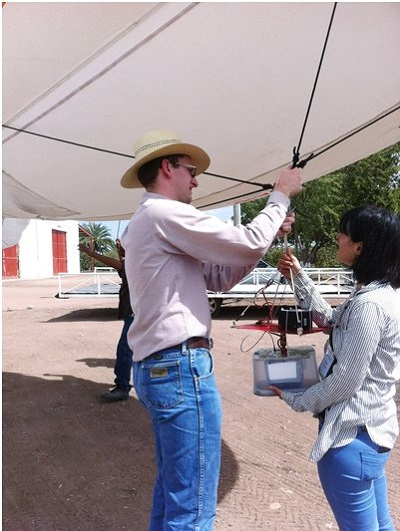 Maria Tattaris and Ph.D. student Jared Crain place a camera on the blimp in Ciudad Obregón, Mexico. Photo: Wheat Physiology Group.