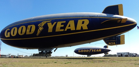 The Spirit of Goodyear sits in the foreground with the Spirit of Innovation behind it. In the background, the Goodyear support tractor-trailer. Photo: Richard Van Treuren