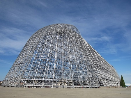 Planetary Ventures, a Google subsidiary, has won a bid to rehabilitate, operate, and manage the Moffett Federal Airfield, including the restoration of the iconic Hangar One. Pictured here is the Hangar One, stripped off of its skin. Photo : NASA