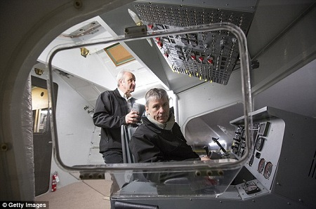 Bruce Dickinson at the controls of the helium-filled aircraft. Source: Daily Mail UK