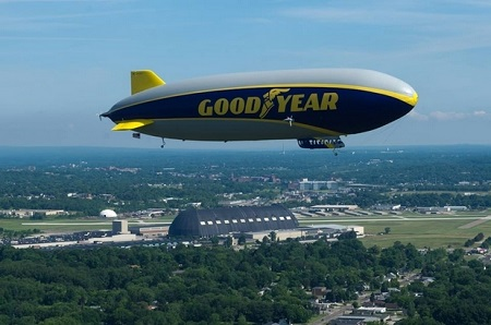 """Goodyear's newest airship, soon to be christened """"Wingfoot One,"""" is shown flying over the former Goodyear Airdock in Akron.  Photo: Goodyear"""