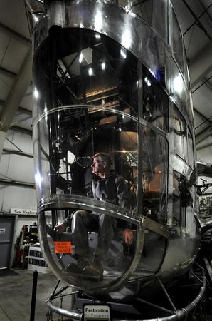 John Craggs of Marlborough, one of the volunteer aircraft restorers, sits at the controls of the Goodyear ZNPK-28 Blimp Control Car that has been undergoing complete restoration for the past 21 years at the New England Air Museum.