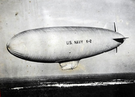 A photograph of a K-class Navy blimp with the Goodyear ZNPK-28 Blimp Control Car attached.