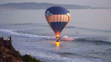In this Sunday, Oct. 5, 2014 file photo, a hot air balloon dips close to the ocean in Cardiff-by-the-Sea, a beach community in Encinitas, Calif.  Photo:  Jenny Parsons - AP