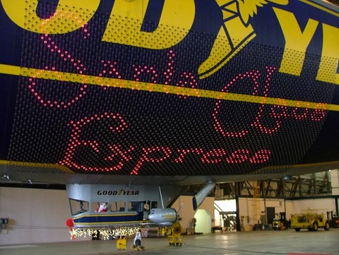 """The Goodyear Tire & Rubber Company's blimp """"Spirit of Goodyear"""" at the company's Toys for Tots collection at its blimp hangar in Suffield Ohio. Photo courtesy of Goodyear Tire 7 Rubber Co."""