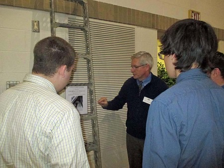 LTAS member Art Paulson explains the use of an Akron/Macon era duraluminum ladder from the LTAS collection to two students from the University of Akron School of Engineering.collection