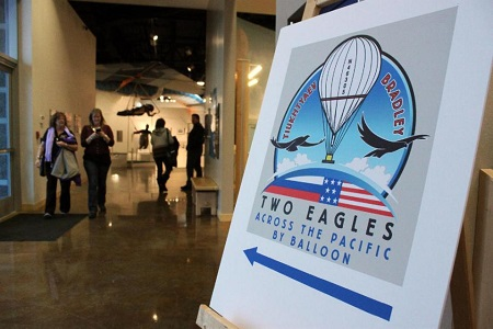 Visitors to the Anderson Abruzzo International Balloon Museum in Albuquerque, N.M., are directed to the mission control center for the Two Eagles Balloon flight on Friday, Jan. 30, 2015. The balloon has surpassed world records for distance and duration during its trip across the Pacific Ocean. It was scheduled to land on Mexico's Baja California peninsula on Saturday, Jan. 31, 2015. Photo: AP/Susan Montoya Bryan