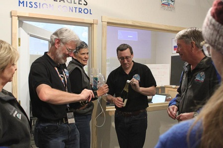 The Two Eagles Balloon mission control team gets ready to pop the cork on a bottle of champagne in Albuquerque, N.M, following the successful landing of the helium-filled balloon just off the coast of Baja California on Saturday, Jan. 31, 2015. Two pilots, Troy Bradley of Albuquerque and Leonid Tiukhtyaev of Russia, in a helium-filled balloon landed safely off the coast of Mexico early Saturday after an audacious, nearly 7,000-mile (11,265-kilometer)-long trip across the Pacific Ocean that shattered two long-standing records for ballooning.  Photo: AP/Susan Montoya Bryan