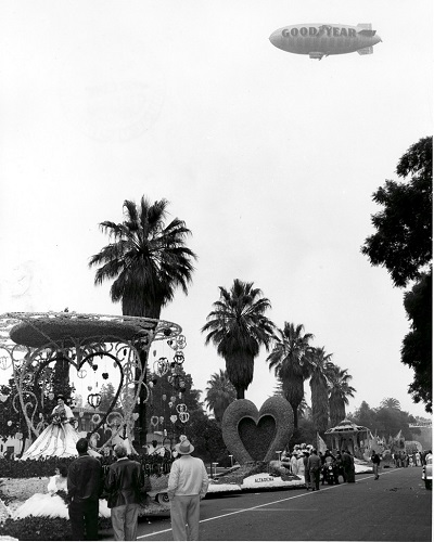 The Goodyear blimp hovers over the 1955 Rose Parade, the first nationally broadcast live aerial shot. Source: insidesocal.com