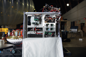 The 15-kilogram box carried by a Loon balloon has computers that act on commands from flight engineers, as well as equipment to transmit Internet connectivity to the ground below. Image courtesy of MIT Technology Review