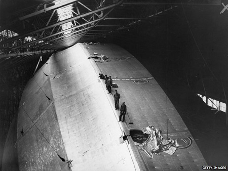Fitters and crew on top of the airship R100, during construction at Howden, East Yorkshire. Photo courtesy of BBC.com