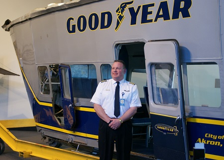 Jerry Hissem, Goodyear Pilot in Charge - Wingfoot One, stand next to the Spirit of Goodyear gondola, now on display at Crawford Auto Aviation Collection. Photo: Alvaro Bellon
