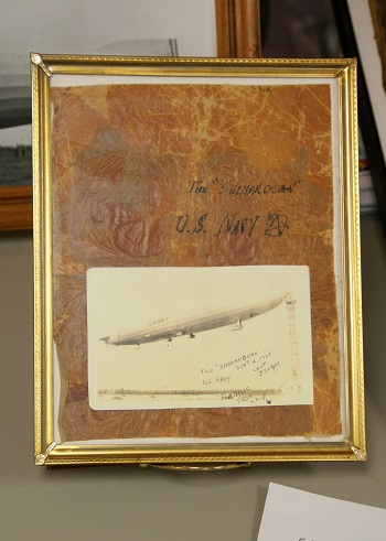 A framed piece of goldbeater and a period post card of the USS Shenandoah. Photo: © Alvaro Bellon