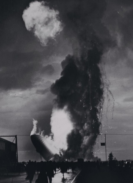 Lakehurst Air Field visitors dash towards the burning Hindenburg shortly after an explosion sent the air ship down in flames. Courtesy of the New York Daily News