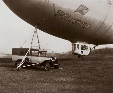 Goodyear's Pilgrim is shown with a belly mooring, an experimental portable mast developed in 1930 to enable cross-country operations independent of permanent hangars.