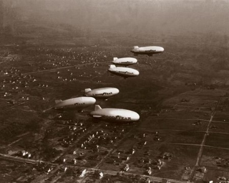 Goodyear's original Akron-based blimp fleet launched from Wingfoot Lake on Nov. 4, 1930, and flew in formation over Akron and the Goodyear Airdock. The aerial blimp parade included the Pilgrim, Neponset, Vigilant, Mayflower, Defender and Puritan.