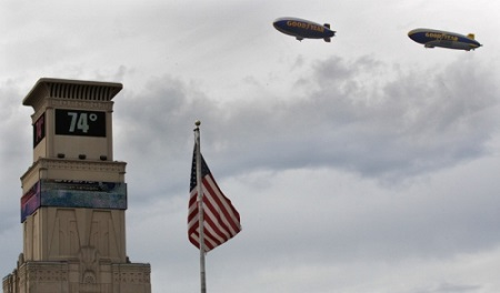 Wingfoot One (right) and Spirit of Innovation, fly over the Akron Beacon Journal headquarters on Wednesday.  Photo: Ed Suba Jr./Akron Beacon Journal