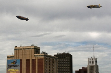 Two Goodyear airships, Wingfoot One (right) and Spirit of Innovation, conduct a tandem flight over the Akron skyline on Wednesday.  Photo: Ed Suba Jr./Akron Beacon Journal