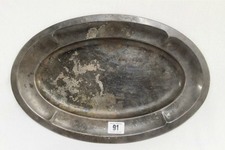 Fire-damaged silver plated serving tray which survived the Hindenburg disaster in New Jersey, US in May 1937. Photo credit: Henry Aldridge & Son/PA Wire